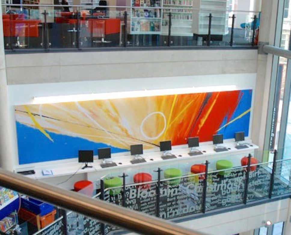 Neil Canning artwork behind reception at Cardiff Library