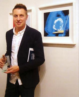 Neil Canning winning DISCERNING EYE award